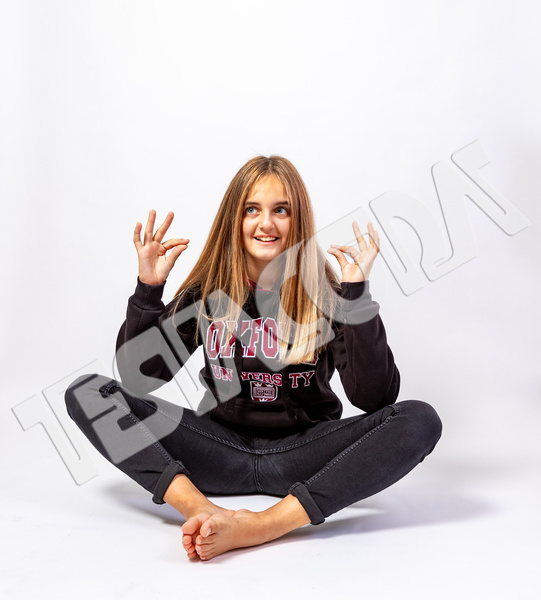 Young Girl in funny oriental pose