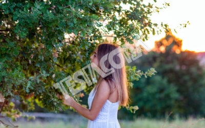 Young Girl in white at sunset
