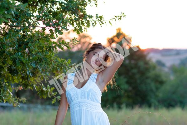Young Girl posing near the magic tree