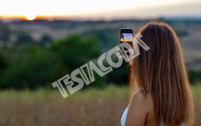 Young Girl taking photos of Sunset